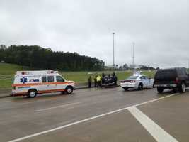 Emergency crews respond about 9:30 a.m. Wednesday after a vehicle flips on Interstate 20 near Gallatin Street.