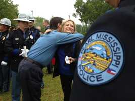 Walter's widow gets a hug after Wednesday's dedication ceremony.