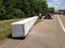 The truck was carrying a long concrete block, which fell onto the interstate.