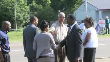 Chokwe Lumumba talks to supporters before casting his vote in the runoff election.