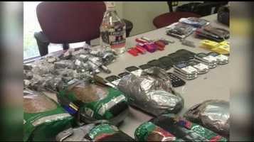Two men are accused of trying to bring these items, including drugs, cell phones and alcohol.