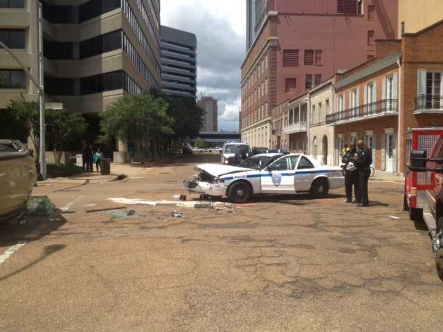 A Jackson police officer transporting a suspect was involved in a crash with a woman driving an SUV, authorities said.
