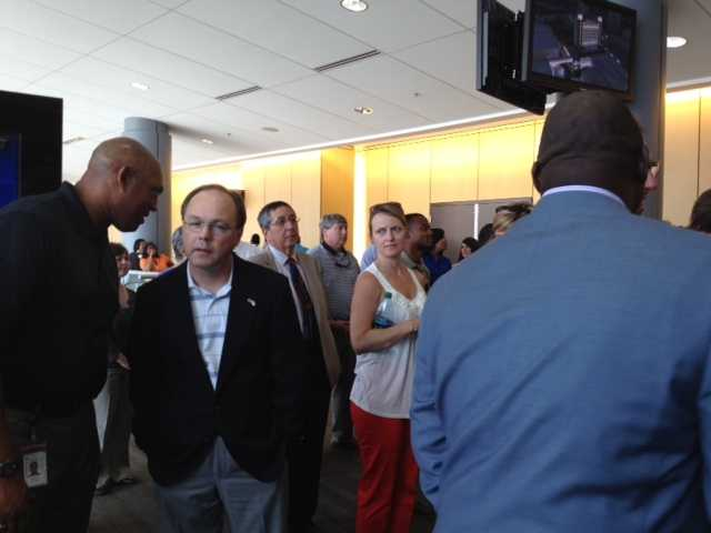 A large crowd attended a news conference Tuesday to learn more about plans for the hotel.