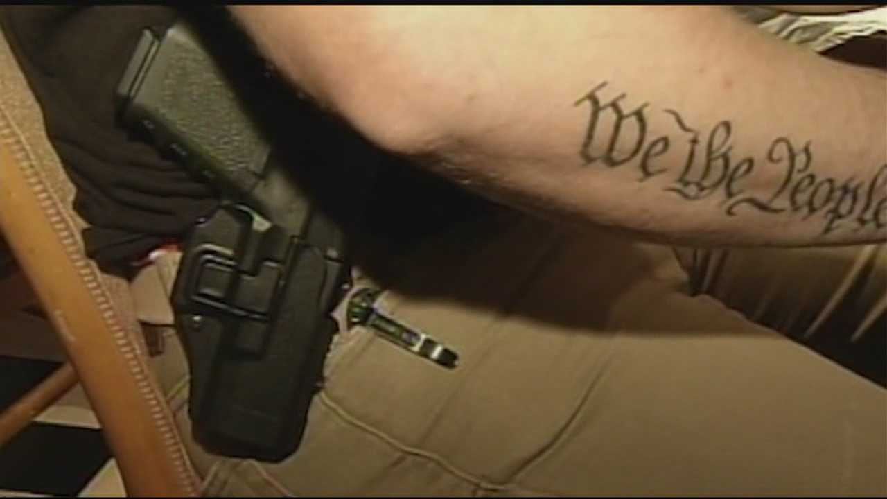 Some state lawmakers are calling on the governor to stop a law allowing guns on the hip.