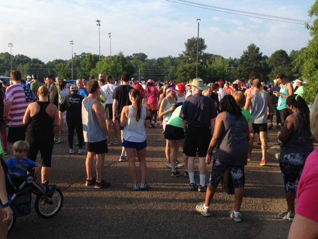 Runners gathered early Fourth of July morning to be at the starting line for 7:30 a.m.