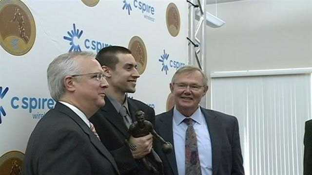 Marshall Henderson, center, was named Mississippi's most outstanding men's college basketball player.