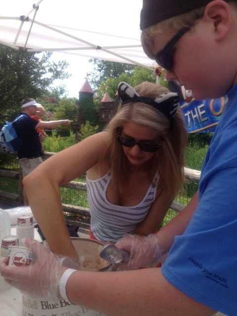 Megan scoops ice cream with the help of Trustmark bank volunteer, Tristan.