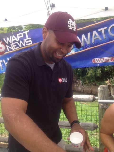 16 WAPT News Director Ben Hart scoops ice cream.