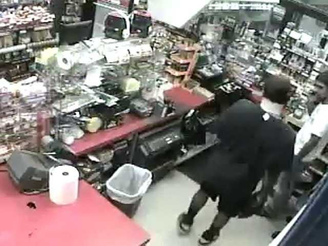 Police have released these surveillance images they say shows the man robbing the business.