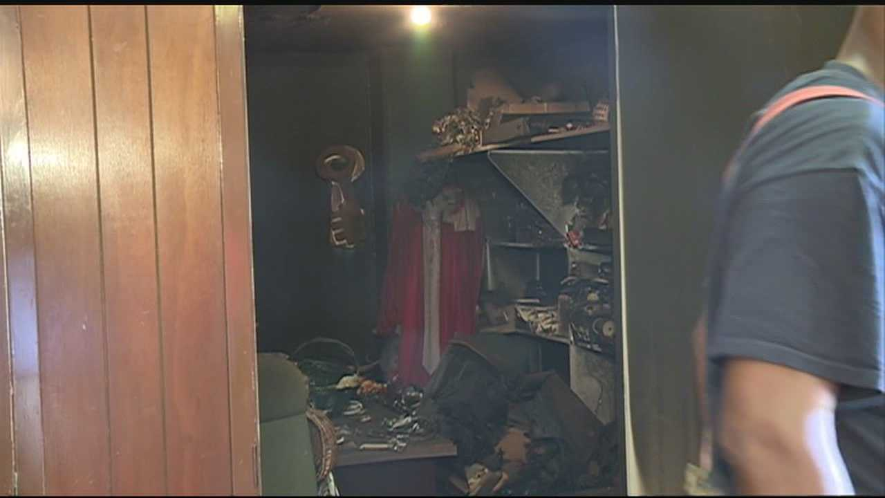 A pastor puts out a fire at his own church set by vandals who ransacked the place.