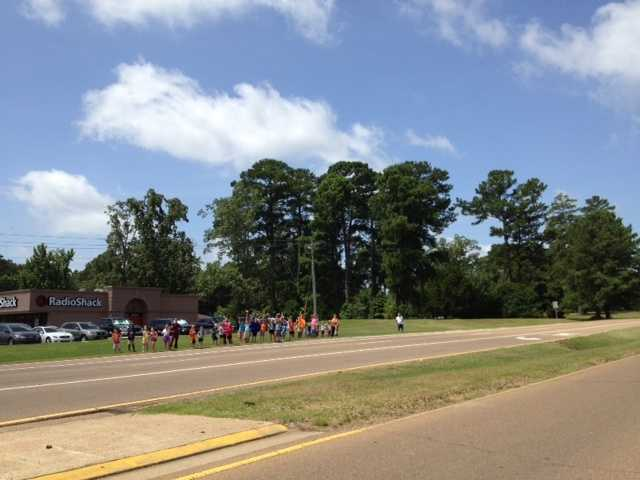 Employees at Walmart were out waving flags along with employees at a veterinarian clinic and a auto repair shop as the funeral procession passed by.