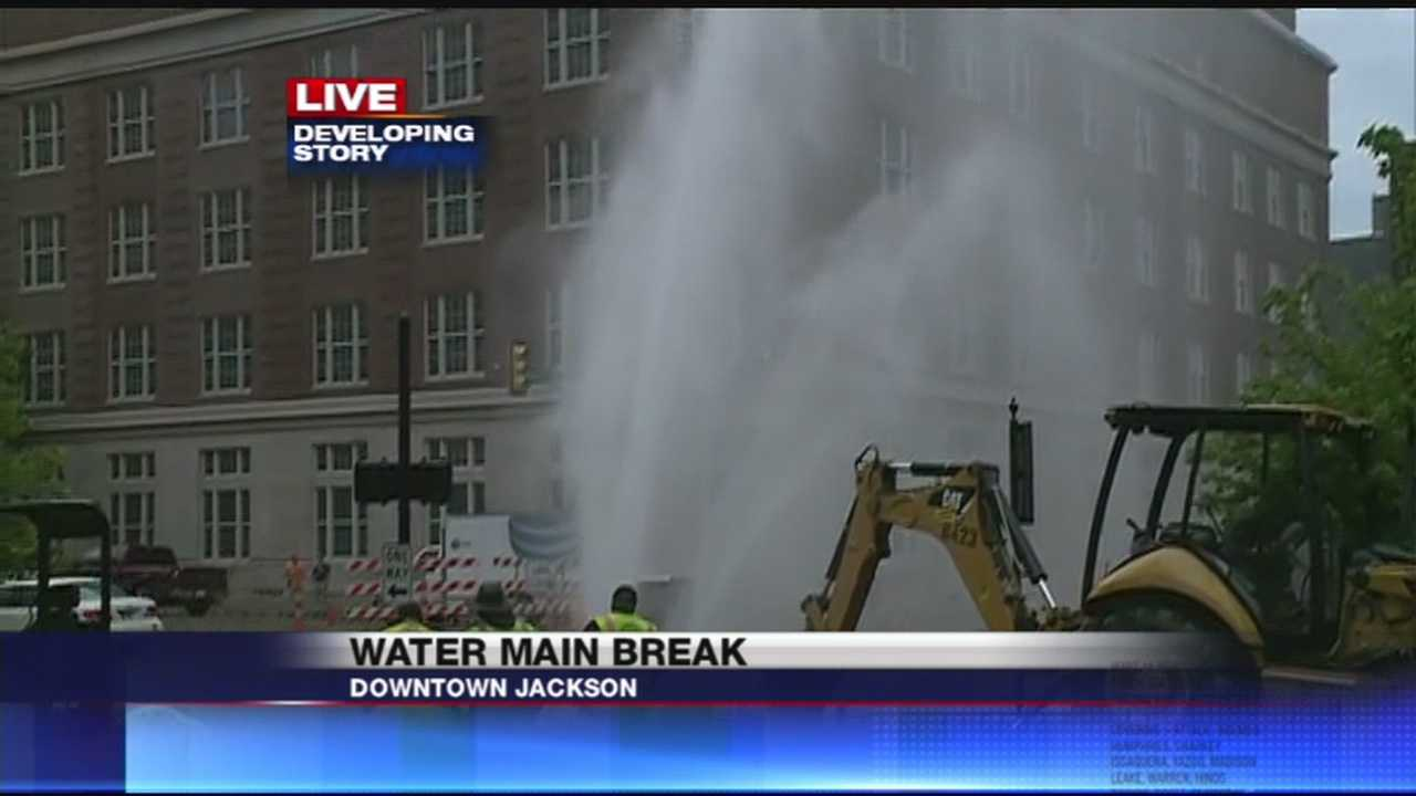 A major-water-line-break in downtown-jackson is shooting water several-stories into the air