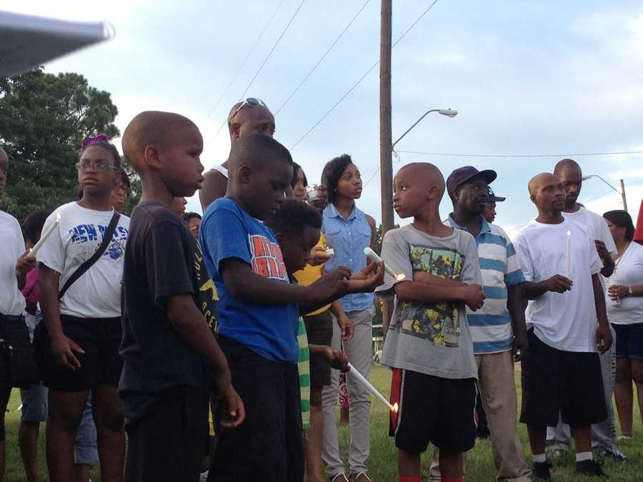 About 250 people attend a candlelight vigil to remember two teenagers shot to death in Jackson.