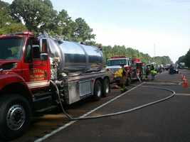 The double-trailer truck was carrying paint, officials said.