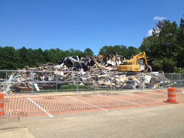What was left an apartment building at the reservoir that went up in flames was demolished on Monday.