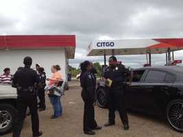 The man walked to the front of a Citgo gas station for help, where he collapsed, witnesses say.