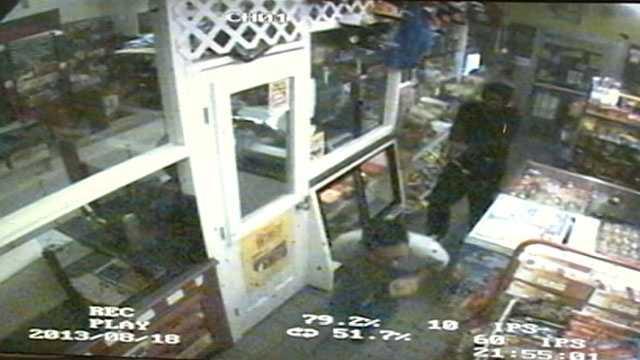 He opens fire on the clerk as he runs away.