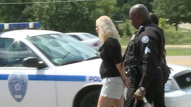 Jackson police say a woman into custody, accused in a hit-and-run witnesses by Warren County Sheriff Martin Pace.