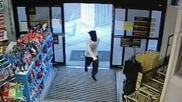 Surveillance cameras capture three armed gunmen running into the Dollar General on Northview Drive in Jackson.