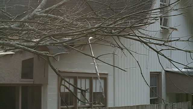 A tree fell on a house Friday morning, injuring a boy, who a relative says is 5 or 6 months old.