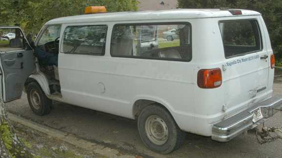 A Magnolia employee tasked with supervising inmates on work release allegedly sleeps inside a city van with his feet resting on the driver's side door in this Aug. 15, 2013, photo courtesy of the Enterprise-Journal.