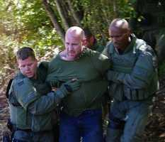 Authorities arrested William Charles Carroll after a standoff in a wooded area of Flowers.
