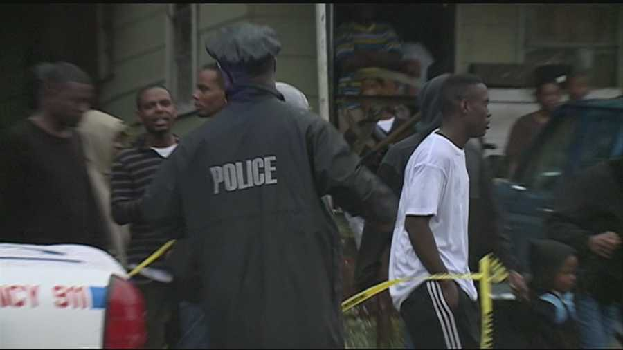 A tense-night for a jackson-neighborhood, as police work to find-out whokilled four-people.