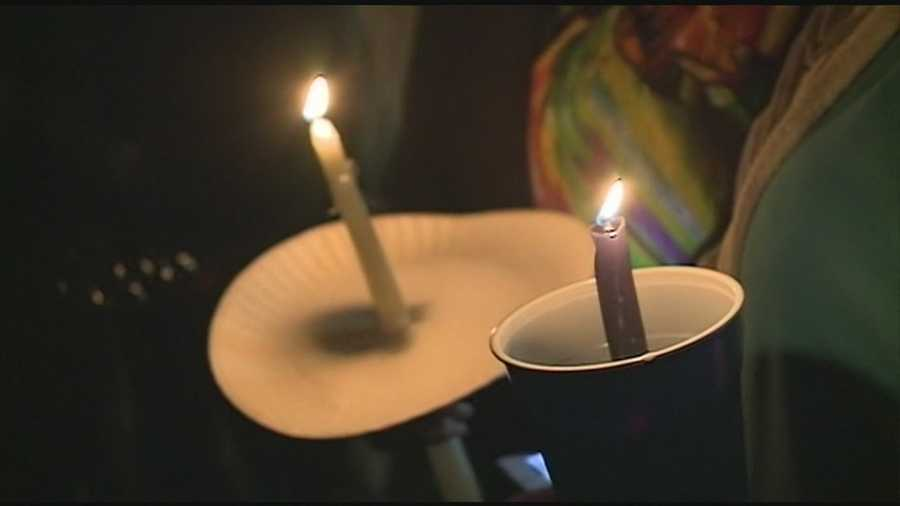 Friends and family gathered Monday night outside a Brandon church to pray for the missing family.