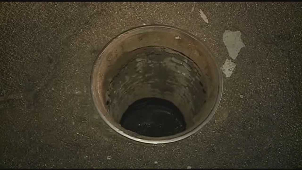 Car gets stuck in manhole