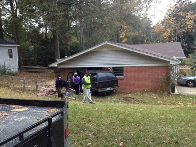 Three people were injured Tuesday when an SUV crashed into a house on Dona Avenue in Jackson.