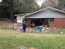 Two people were inside the house, but weren't injured in the crash.