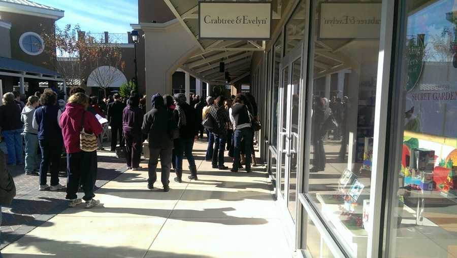 Shoppers gathered early to wait for the stores to open.