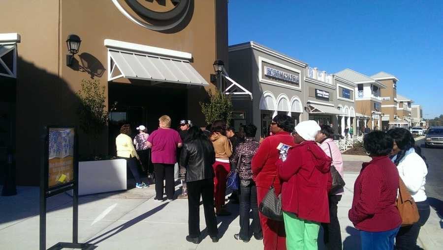 Lines formed outside the stores as shoppers waited for the doors to open.