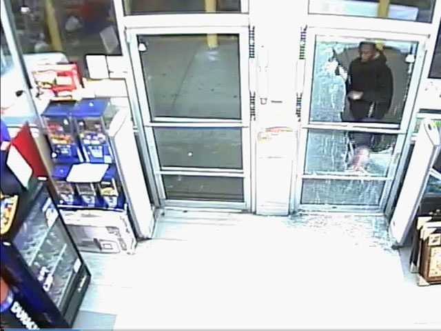 The man was seen in the video throwing bricks through the window of the store and then taking items from inside, police say.
