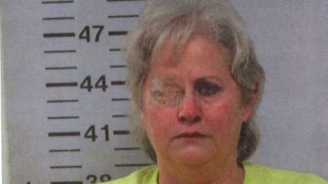 In her mugshot, Mary Lou Neely is shown wearing a patch over her eye. She was wearing it because of an apparent medical condition that was unrelated to the case, Warren County officials said.