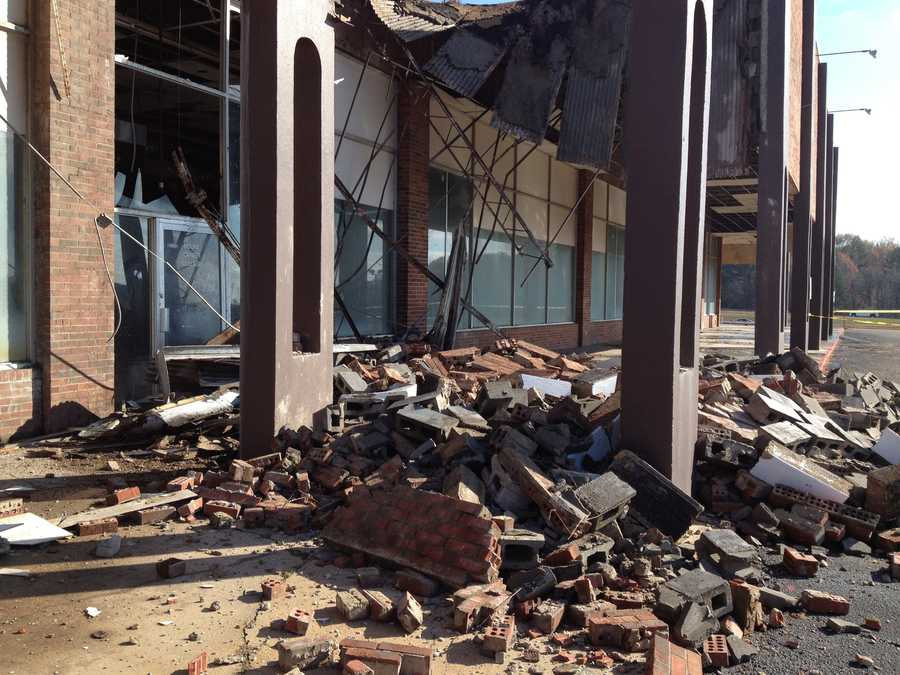 An unoccupied building collapsed at Jackson Square Promenade Mall on Terry Road.