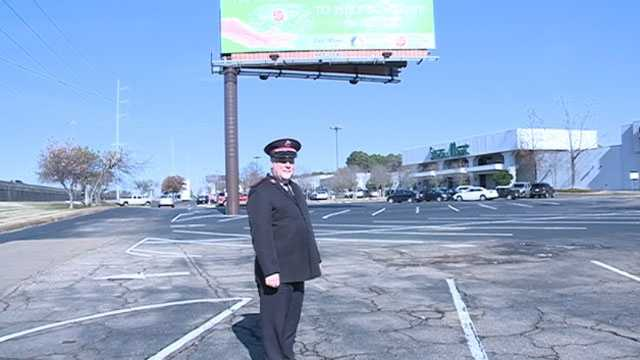 Chapman in front of billboard
