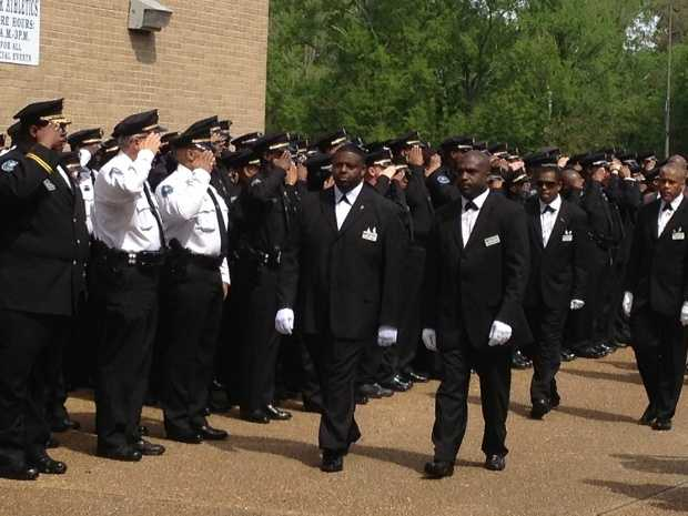About 3,000 officers, friends and family members attend a funeral for slain Jackson police Detective Eric Smith, who was killed April 4 at JPD headquarters while questioning a murder suspect. Click here and here for more pictures.