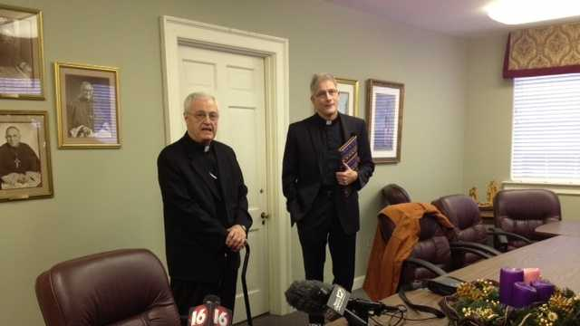The Rev. Joseph Kopacz, right, succeeds Bishop Joseph Latino.