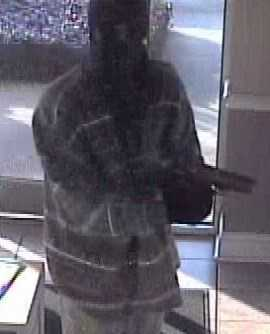 Surveillance video showed one of the masked gunman during a bank robbery in which a police officer was killed.