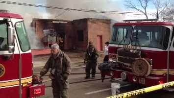The city's maintenance shop on Jefferson Street is engulfed in flames.