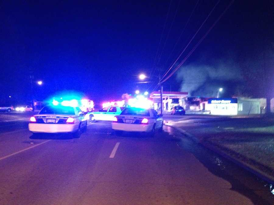 After grabbing the cash register, the men set the clerk and the building on fire, police said.