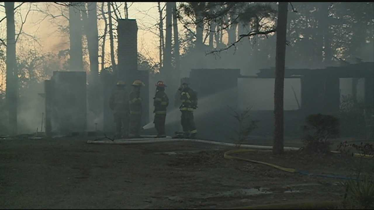 Fire crews spent all afternoon fighting flames- leaving a house in ruins and a road shut down.