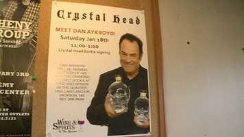Aykroyd signed bottles of Crystal Head Vodka, the company he co-founded.