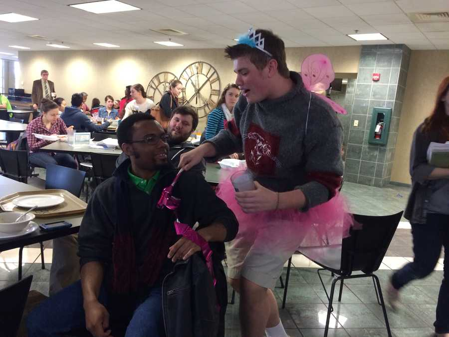 Andrew the singing cupid serenades folks on Valentine's Day.