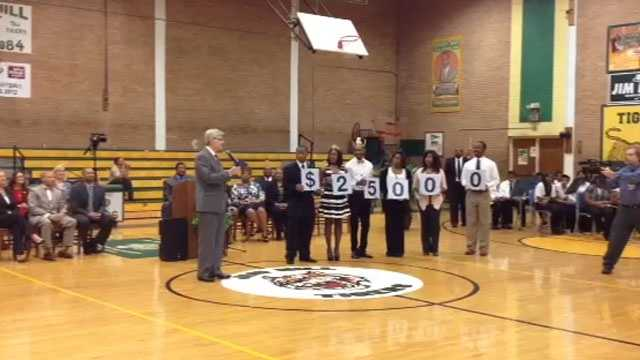 During a presentation at Jim Hill High School, Gov. Phil Bryant announces that a teacher at the school has been chosen for the Milken Educator Award and will be given $25,000.