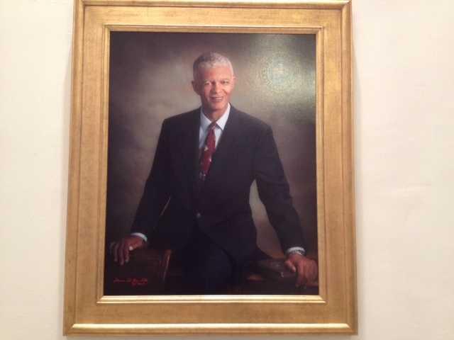 A portrait of Jackson Mayor Chokwe Lumumba hangs in City Hall.