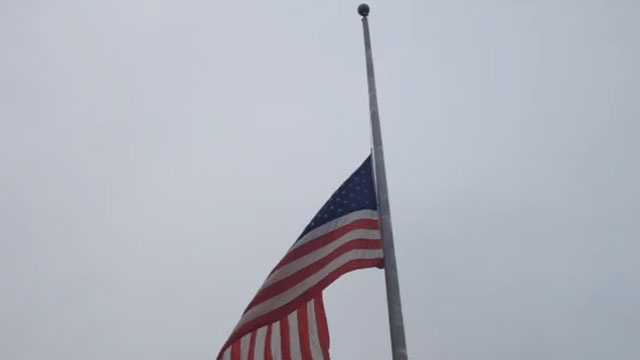 The flag outside Thalia Mara Hall flies at half-staff in honor of Mayor Chokwe Lumumba, who died at age 66.