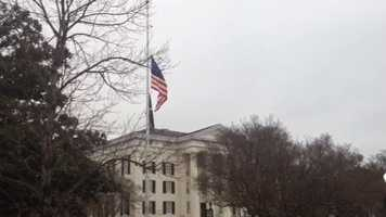 The flag flies at half-staff outside City Hall, the day after Mayor Chokwe Lumumba died.
