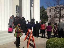 City employees line up to view the mayor, who is lying in state at Jackson's City Hall.
